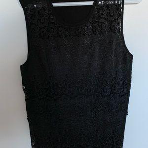 Sleeveless black lace top.